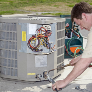hvac mechanic performing air conditioner repair