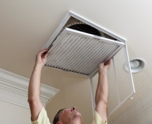 HVAC Repair Service replaces air filter